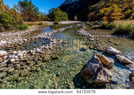 Rocky River Bed of the Crystal Clear Frio River.  Fall foliage.