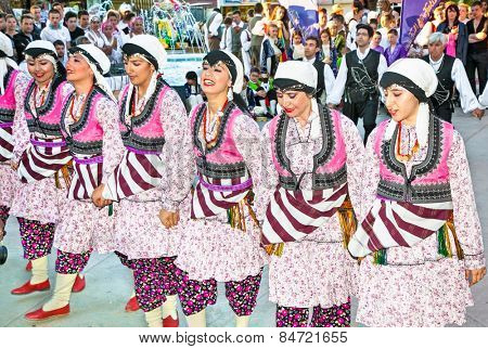 CHANIOTIS , GREECE - MAY 18, 2014 : International children's folk-dance festival on May 18. 2014 in Chaniotis, Greece. Chaniotis visit more than 200 000 European tourists every year.