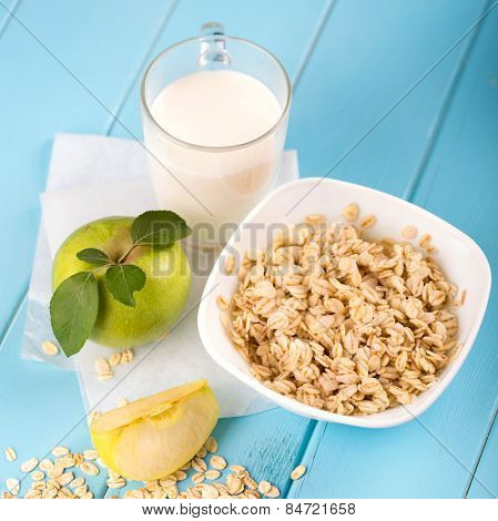 healthy breakfast with milk, fruit and oatmeal
