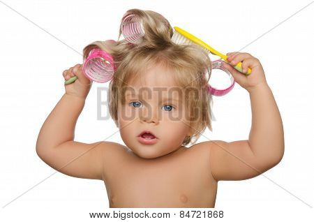 Little Beautiful Girl With Hair Curlers And Comb