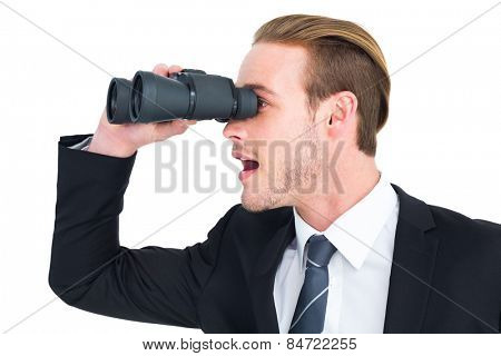 Surprised businessman looking through binoculars on white background