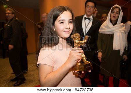 BERLIN, GERMANY - FEBRUARY 14: H. Saedi, golden bear on behalf of her uncle Jafar Panahi. Closing Ceremony. 65th Berlinale Film Festival at Berlinale Palace on February 14, 2015 in Berlin, Germany.