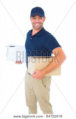 Portrait of smiling delivery man with package and clipboard on white background