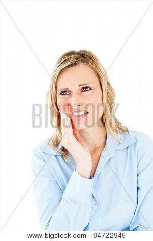 Dejected businesswoman with toothache against a white background