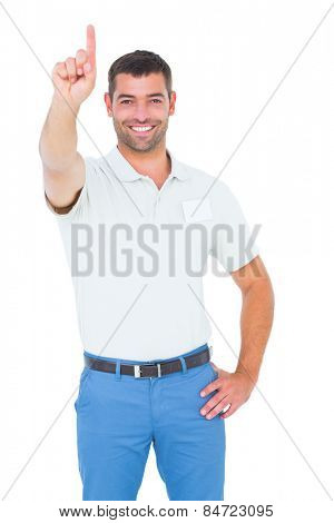 Portrait of happy male technician pointing upward on white background