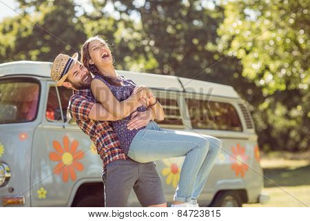 Hipster couple having fun together on a summers day