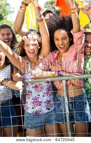 Excited music fans up the front at festival on a summers day