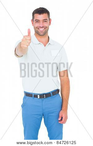 Portrait of happy male technician gesturing thumbs up on white background