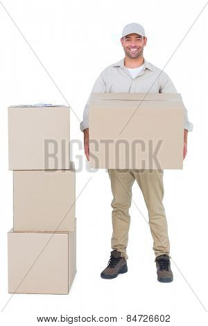 Full length portrait of courier man carrying cardboard box on white background