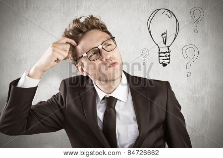 Young geeky businessman scratching his head against white background