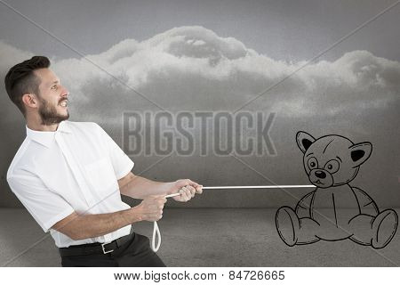 Hipster businessman pulling a rope against clouds in a room