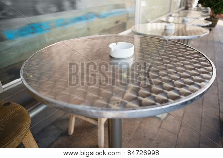 Bar stool and table with ash tray at the bakery