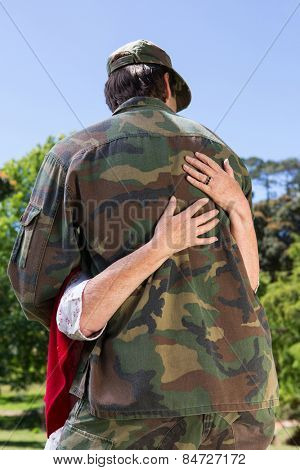 Soldier reunited with his parents on a sunny day