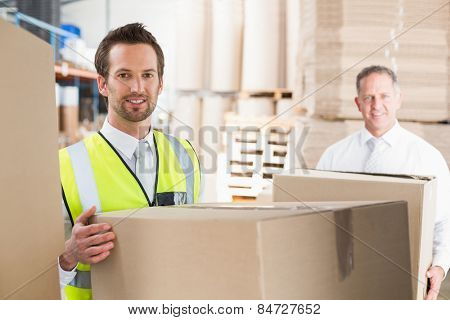 Delivery driver loading his van with boxes outside the warehouse
