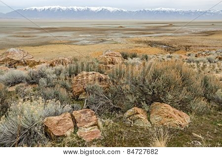Rocks, Salt Lake, And Mountains