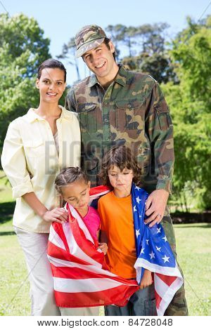 American soldier reunited with family on a sunny day