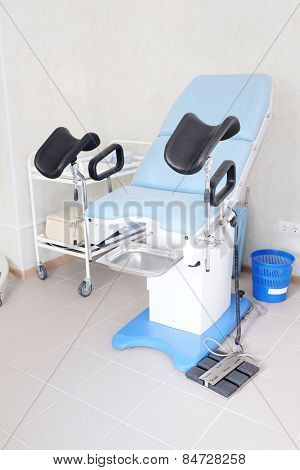 The image of blue gynecological chair