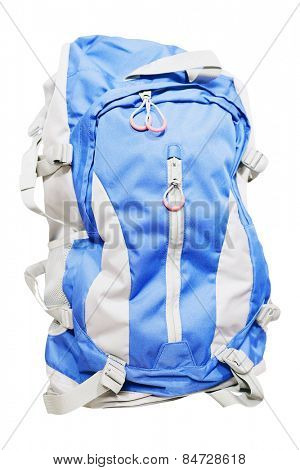 Blue tourist rucksack under the light background