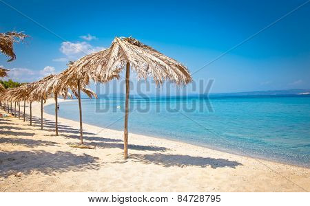 Beautiful Paradiso sand beach on Akra Glarokavos, Kassandra peninsula, Hakidiki, Greece.