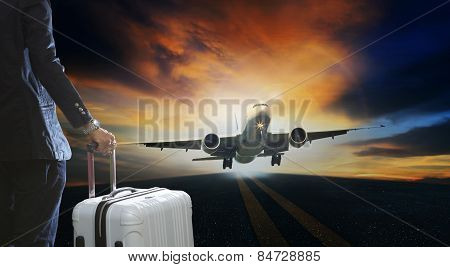 Young Business Man And Luggage Suitcase Standing With Passenger Plane Take Off From Runways Against