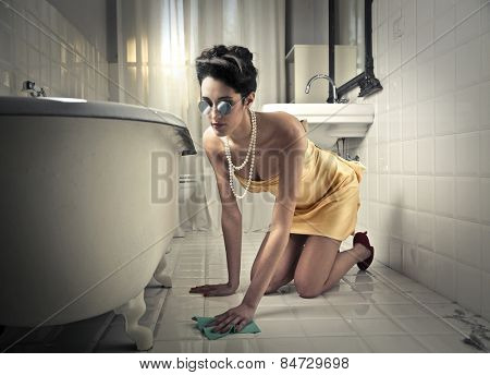 Elegant woman cleaning up