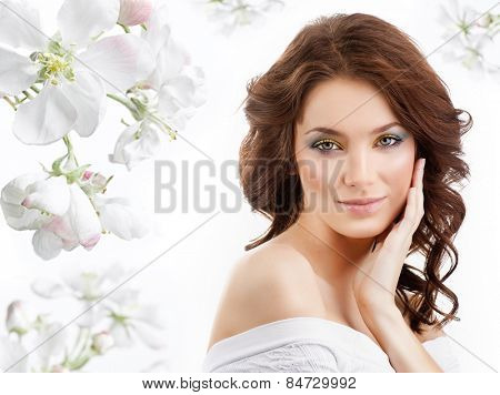closeup portrait of attractive  caucasian  woman brunette isolated on white studio shot lips  face hair head and shoulders looking at camera skin makeup spring flowers