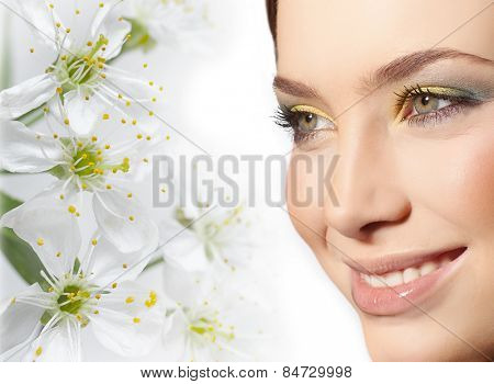 closeup portrait of attractive  caucasian smiling woman brunette isolated on white studio shot lips toothy smile face closeup makeup head  tooth eyes spring flowers