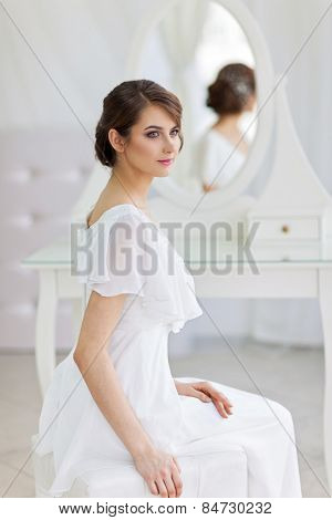 Portrait of beautiful woman in girlish bedroom