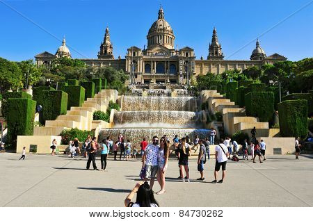 BARCELONA, SPAIN - AUGUST 16: Waterfall fountain and Palau Nacional in Montjuic on August 16, 2014 in Barcelona, Spain. All the area, built for the 1929 International Exposition, is a popular landmark