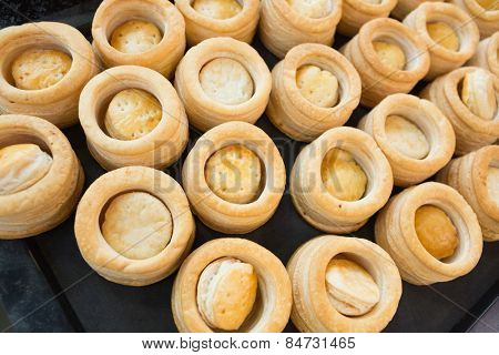Pastry case of vol-au-vent in the kitchen of the bakery