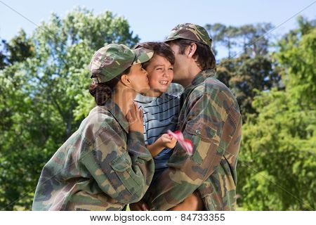 Army parents reunited with their son on a sunny day