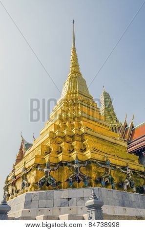 Bangkok, Thailand - Giants under golden pagoda in Royal Palace and Wat Phra Kaeo Complex
