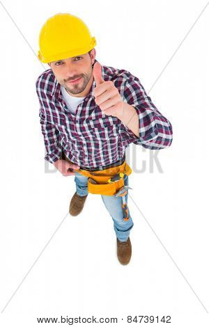 Smiling handyman with thumbs up on white background