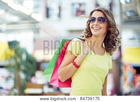 Pretty shopper with paperbags in the mall