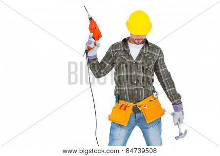 Repairman holding hammer and drill machine on white background