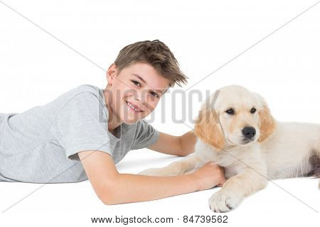 Portrait of happy young boy with dog over white background