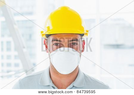 Portrait of confident handyman wearing protective workwear at site