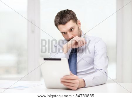 office, business, technology, finances and internet concept - stressed businessman with tablet pc computer and documents at office