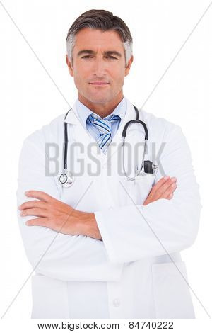 Serious doctor looking at camera on white background