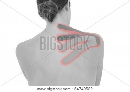Rear view of a topless young woman with red and green strips on shoulder over white background