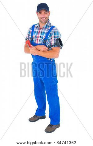 Full length portrait of male plumber holding plunger and wrench on white background