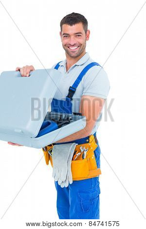 Portrait of happy repairman opening toolbox on white background