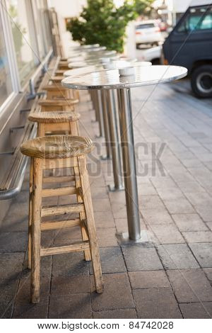 Bar stool and tables on the terrace at the bakery