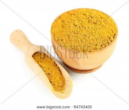 Curry in wooden bowl, isolated on white