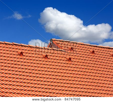 Abstract red tiled roof on blue sky background