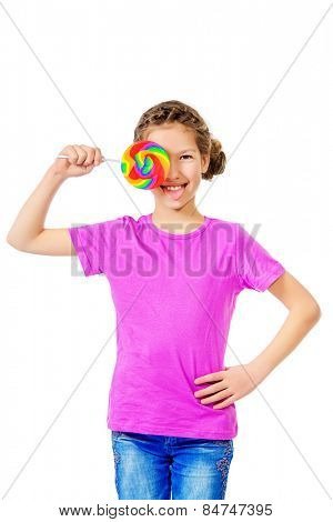 Smiling teen girl enjoys her huge lollipop. Studio shot. Isolated over white.