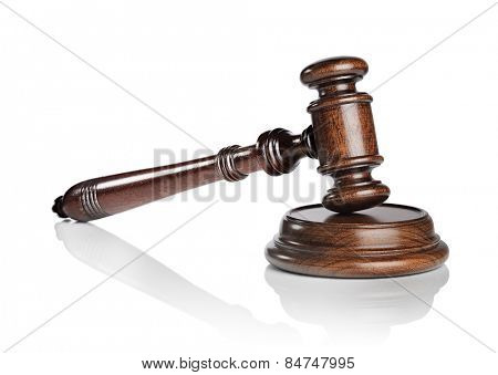 High quality mahogany wooden gavel with a sound block isolated on white with natural reflection.