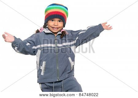 Cute and adorable multiracial little girl wearing a colorful beanie hat and a jacket