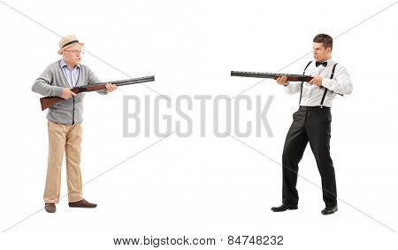 Mature man and a young guy having a shootout with shotguns isolated on white background