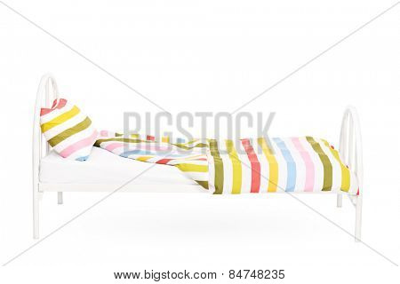 Studio shot of an empty bed isolated on white background